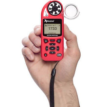 Kestrel 5100 Racing Weather Meter in hand
