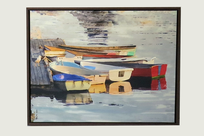 Colorful dinghy dock of Red and blue dinghies in  golden afternoon light. Framed in Solid brown hand wood  frame.