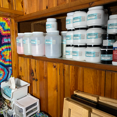The wall cubby shelf that holds all extra, backup 5lb, 1lb and 8oz Dharma Trading Co. Fiber Reactive Procion Dye colors
