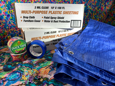 Image of 10 x 100 multi-use plastic sheeting, tie dye duck tape, painters tape, thumb tacks and a tarp with a tie dye tapestry in the background