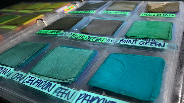 Dharma Fiber Reactive Dye Color Catalog Binder Opened to Pages Featuring Green and Teal Shades