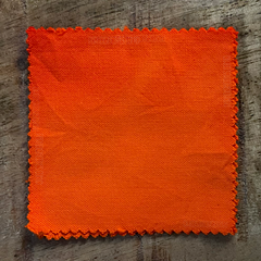 A True-to-Color Swatch, Taken Under Natural Sunlight on a 100% Color Sample Square of Dharma Trading Co. Procion Fiber Reactive Dye in Color Deep Orange