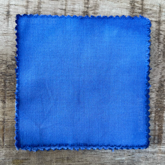 A 100% Cotton Square Piece of Fabric Depicting Dharma Trading Co. Fiber Reactive Procion Dye in Color ICE BLUE, pictured under natural sunlight