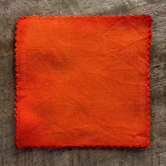 A True-to-Color Swatch, Taken Under Natural Sunlight on a 100% Color Sample Square of Dharma Trading Co. Procion Fiber Reactive Dye in Color Orange Crush