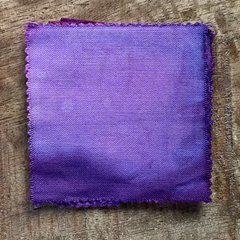 A 100% Cotton Square Piece of Fabric Depicting Dharma Trading Co. Fiber Reactive Procion Dye in Color Plum Blossom, pictured under natural sunlight
