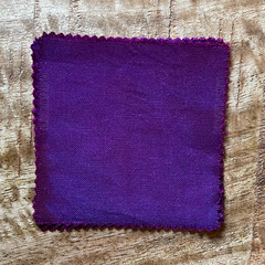 A 100% Cotton Square Piece of Fabric Depicting Dharma Trading Co. Fiber Reactive Procion Dye in Color Raspberry, pictured under natural sunlight