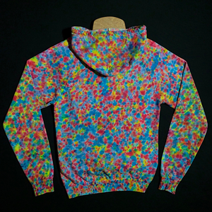 Size small American Apparel tie dye pullover hoodie featuring our exclusive, supreme splatter pattern tie dye design - reminiscent of speckled paint spatter. Boasting intense rainbow colors, including shades of blues, pinks and yellows. Features a Drawstring hood and large kangaroo front pocket.