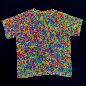 Back side of Youth small tie dye shirt featuring a paint splatter reminiscent pattern with vibrant neon rainbow colors, primarily Shades of: pink, orange, yellow, green and blue