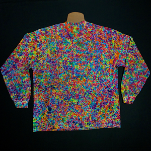Back Side of Size XXL long sleeve tie dye t-shirt featuring dozens of vibrant rainbow colors In our paint spatter reminiscent speckled splatter pattern tie dye design. Also similar to the crinkle, crumple and scrunch tie dye folds.