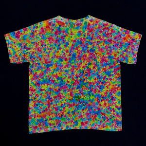 Youth small tie dye shirt featuring a paint splatter reminiscent pattern with vibrant neon rainbow colors, primarily Shades of: pink, orange, yellow, green and blue