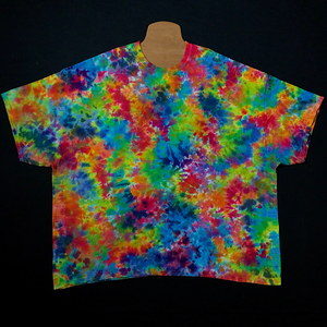 Size adult 5X tie dye short sleeve shirt featuring splatter pattern and vibrant rainbow colors