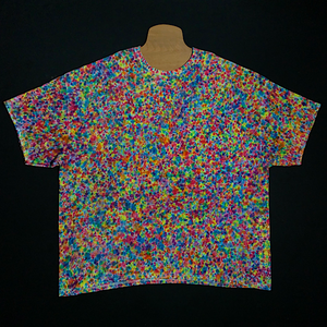 Size Adult 4X Gildan Heavy Cotton Tie Dye Shirt Featuring Vibrant Rainbow Colors in Our Exclusive, Extraordinary Splatter Pattern Tie Dye Design! Loaded with an Unbelievable Amount of Rainbow Colors, Reminiscent of a bowl of the popular Colorful pebble cereal.