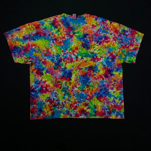 Back side of size adult 3X plus size short sleeve tie dye shirt. Features a splatter tie dye pattern with rainbow colors, primarily: red, pink, orange, yellow, green and blue shades