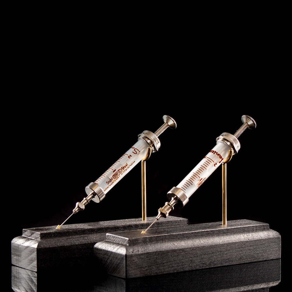 Vintage unbranded syringe on bespoke base