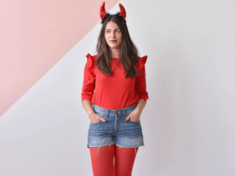 DIY Halloween devil costume created with red tights, a red top and denim shorts.