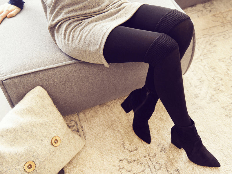 Our winter-approved over-the-knee tights pair perfectly with a grey dress.