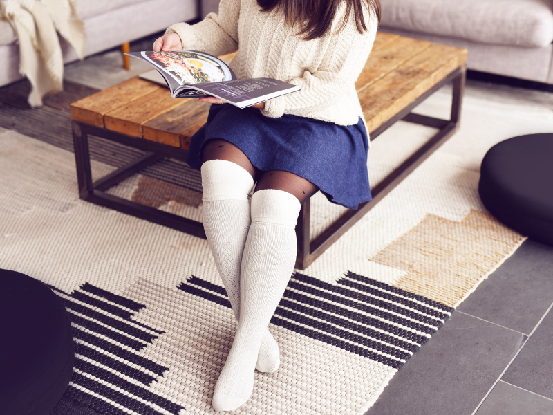 70623adde2949 For a fashion-forward look, be sure to play with proportions when styling  your over-the-knee socks. Keep your look conservative, by wearing layers  such as a ...