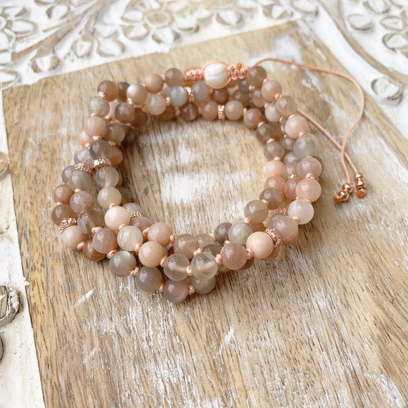 Sunstone Adjustable Mala with White Shells Guru Bead