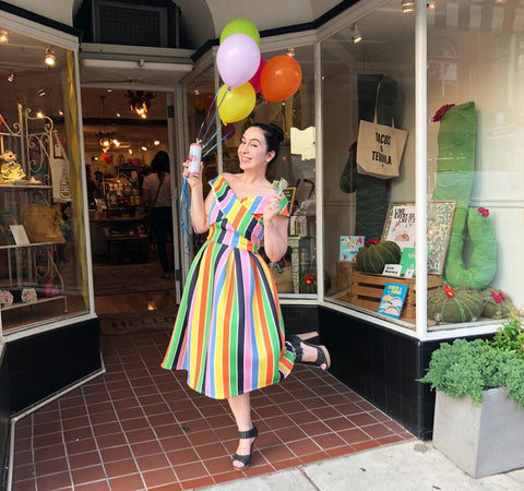 The Little Apple owner Brandy Deieso in front of shop on anniversary.
