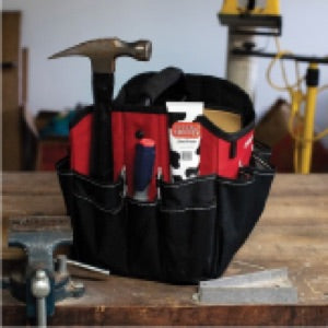 a photo of a tube of Udderly Smooth sitting in a tool belt along with a hammer and a screwdriver
