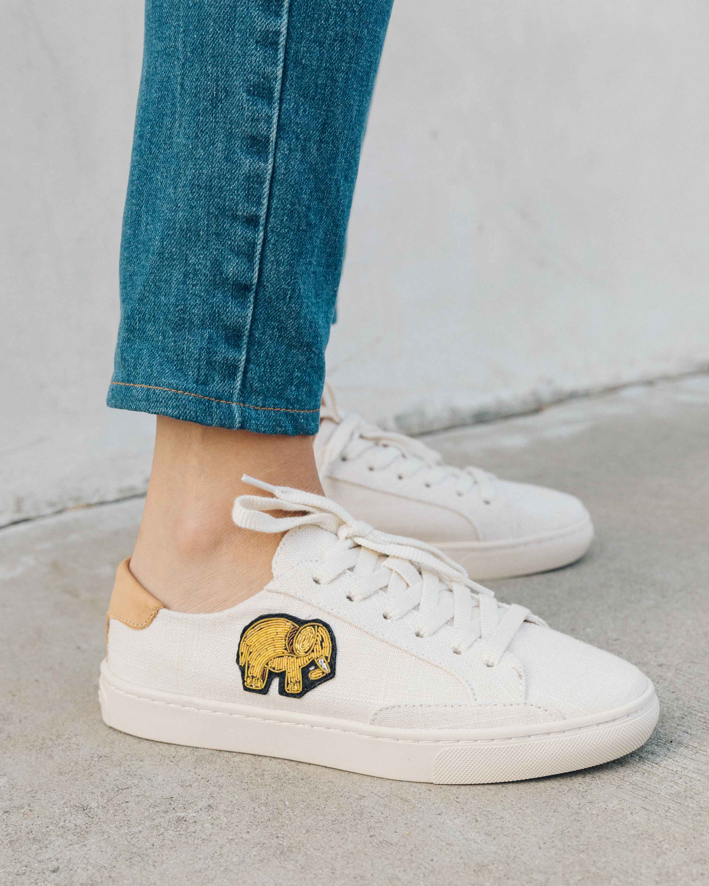 Introducing your new sneaker soulmateDon't be fooled by their charmingly simple exterior of these minimalist sneaks: We lined the sole in super cushy cork that molds to your foot so they're really lightweight and comfortable. Bonus: The coil embroidery hand-done by our team.