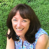 Gina Anderson headshot - she founded Good Paws Bakery, loves to make dogs happy and was a prior human factors engineer