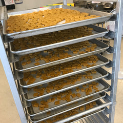 racks of grain free good paws treats in the shared commercial kitchen