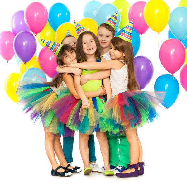 Children with balloons at a birthday party