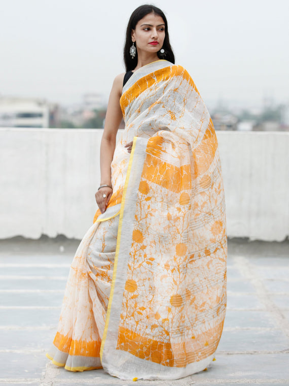 White Golden Yellow Batik Printed Handwoven Linen Saree With Zari Border & Tassels - S031703770