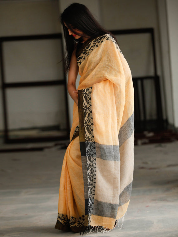 Pastel Peach Beige Black Handwoven Linen Saree With Tassels - S031703787