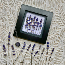 pressed lavender framed picture and stainless steel locket.
