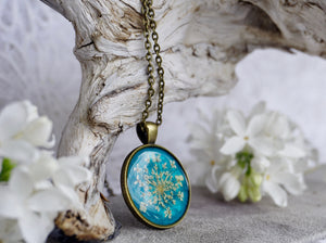 Real Pressed Queen Annes Lace Antique Bronze Pendant on Teal Background by Pressed Wishes; Proudly handmade in Canada