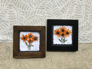 Pressed black eyed susan framed artwork available in black and walnut frame