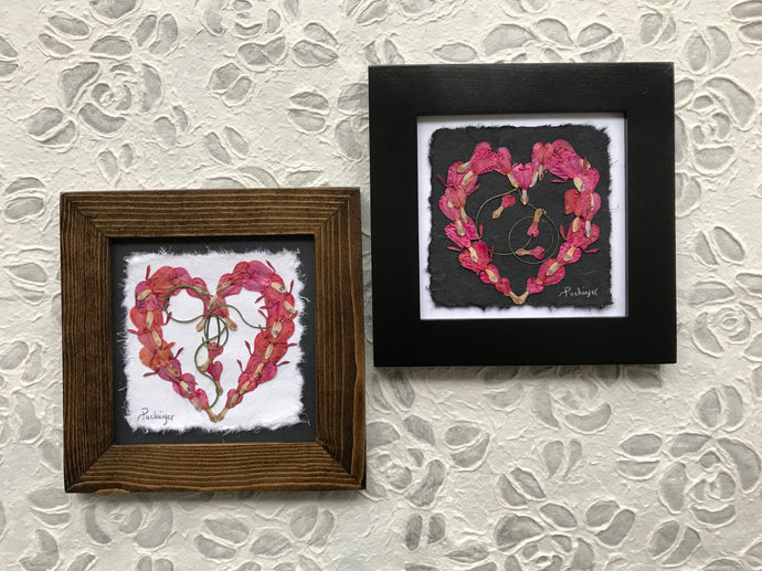 Dried flower art - pressed bleeding heart floral art in heart formation; available in black and walnut frame