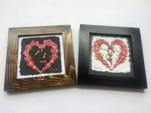 pressed bleeding heart in heart shape; perfect for valentines day. black and brown frame