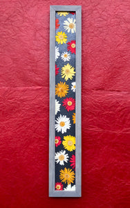 THE SKINNY Crazy Daisy with grey frame; hangs horizontally or vertically