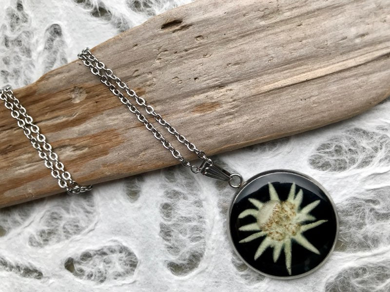 pressed edelweiss stainless steel pendant sealed in eco friendly resin