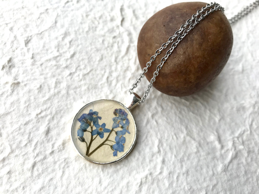 pressed forget me not necklace in silver pendant