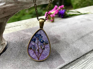 Pressed Forget Me Not Flowers on Sparkly Purple Handmade Paper by Pressed Wishes - Resin Jewellery Handmade in Canada
