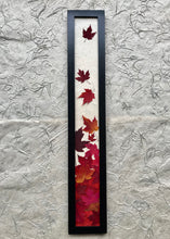THE SKINNY Red maple leaf framed artwork with black frame; handcrafted in canada
