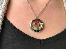 Real pressed red rosebud locket necklace on model by Pressed Wishes. The locket is made of silver stainless steel and glass. Model wears an 18 inch chain. Proudly handmade in Canada