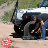 man inflating jeep tire