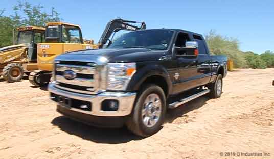 superduty black in dirt construction site