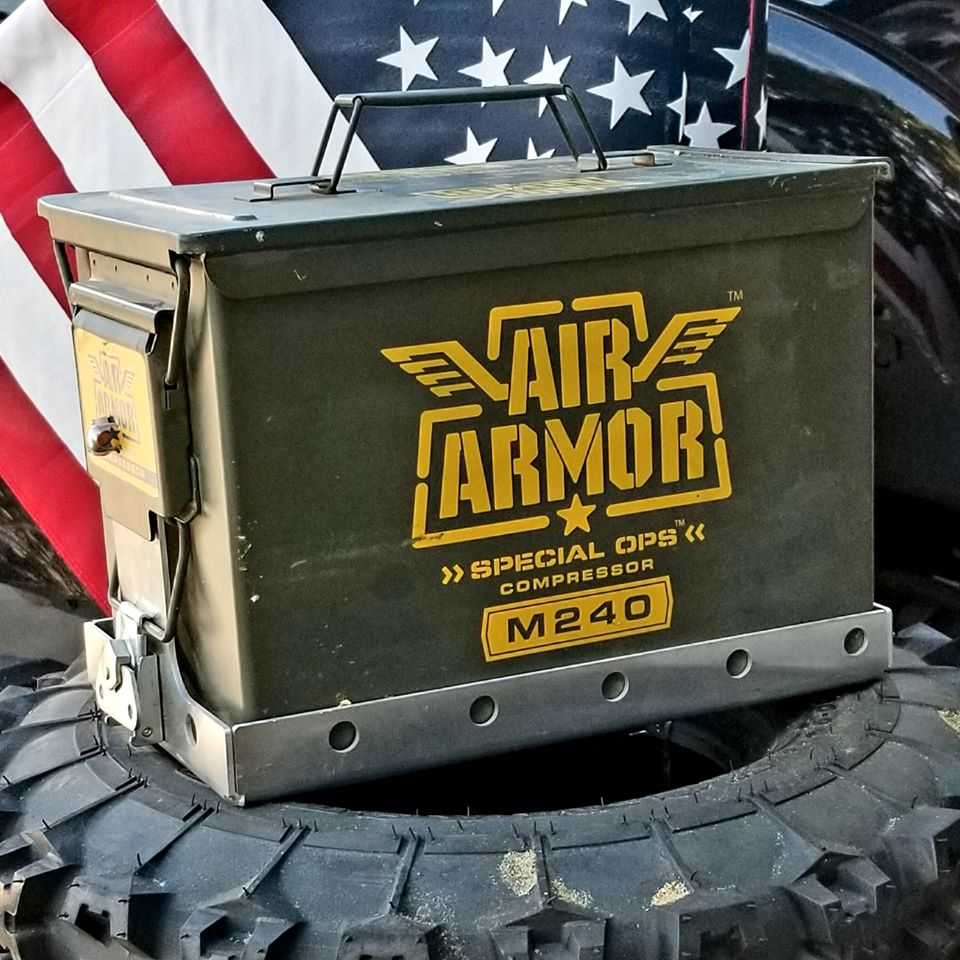 green air armor inflator in steel ammo ammo can sitting on off road tire