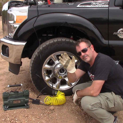 twin cylinder tire pump inflating truck tire