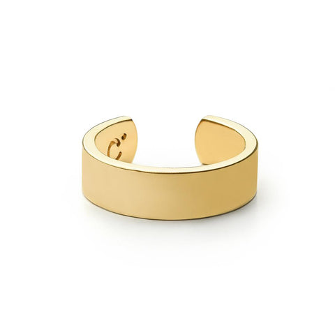 A slim gold cuff ring with inscription