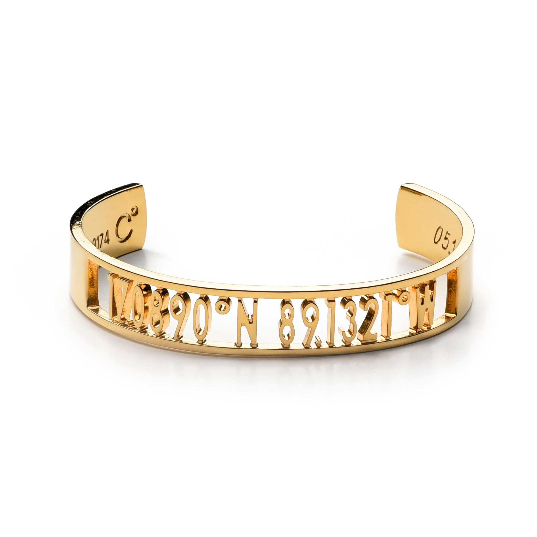 A wide gold cuff bracelet with carved out inscription