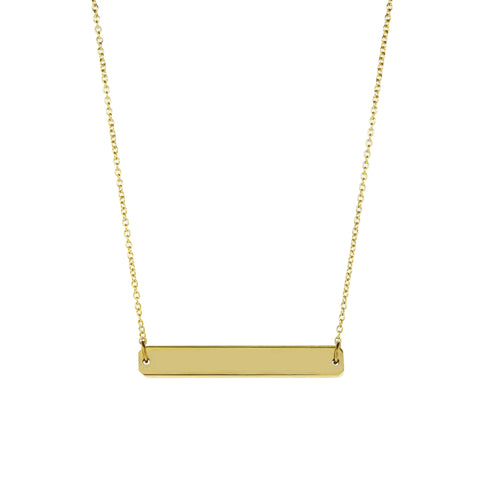 A straight horizontal gold pendant with inscription on a gold chain