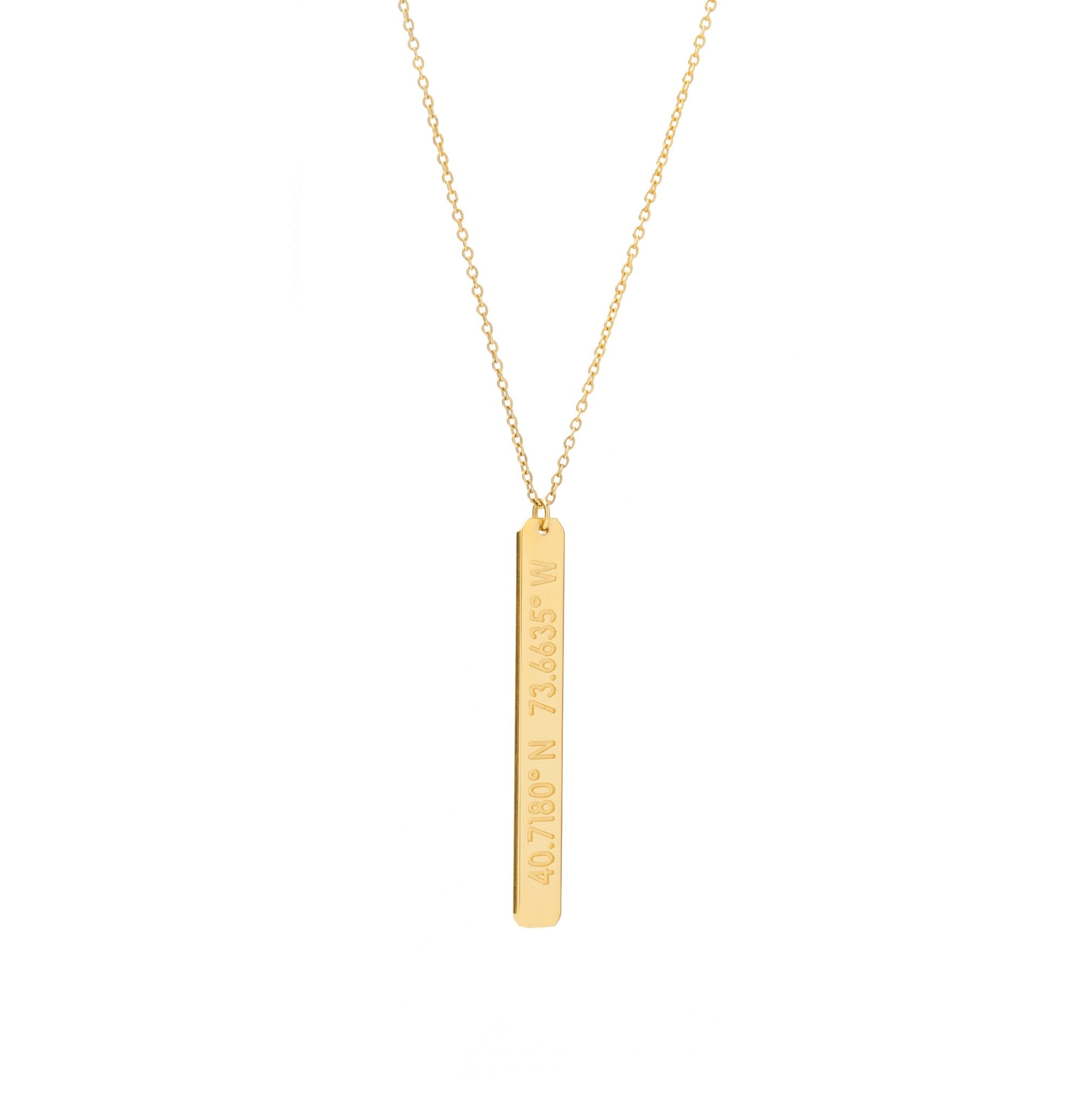A long gold vertical pendant with inscription on gold chain
