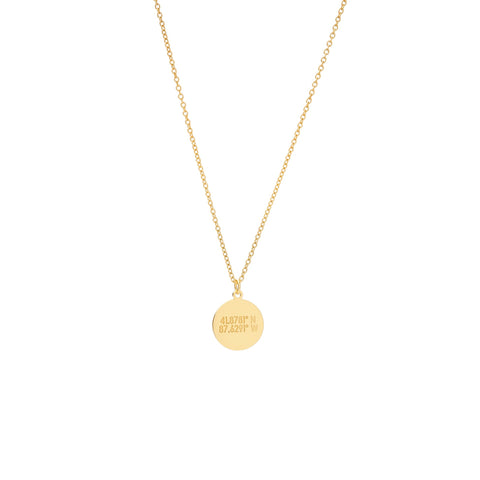 A smal flat circular gold pendant with inscription on a gold chain